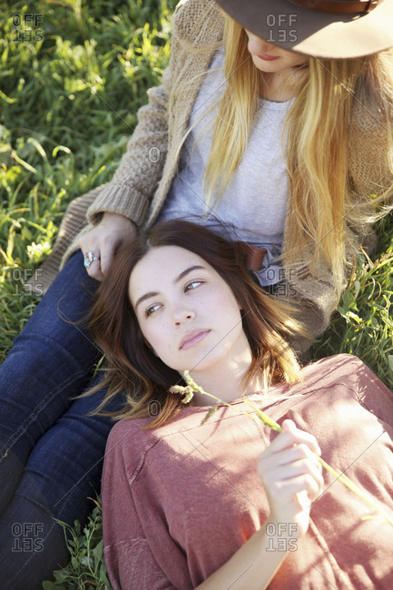 Friends relaxing in the grass