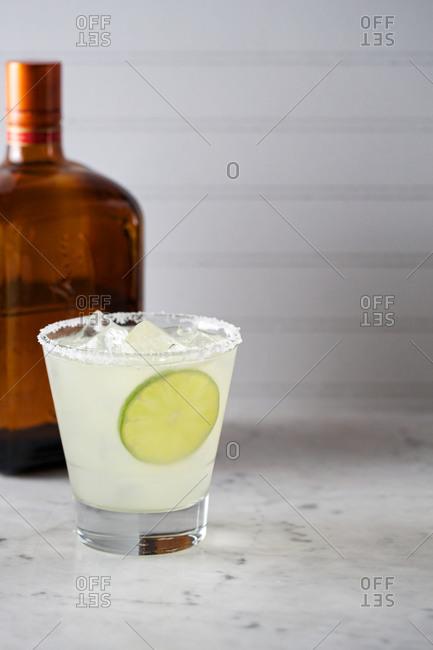 Triple-sec cocktail in a salt-rimmed glass