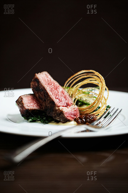 Rare steak served with fried onion