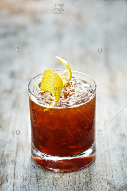Cocktail served with a lemon twist