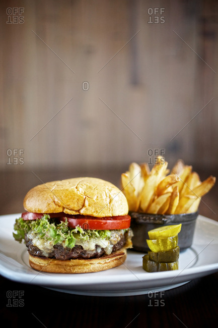 Hamburger with pickles and fries