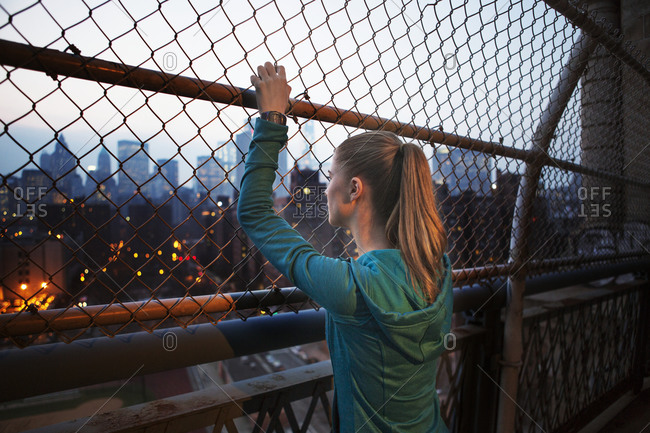 A woman looks at the New York skyline during a workout