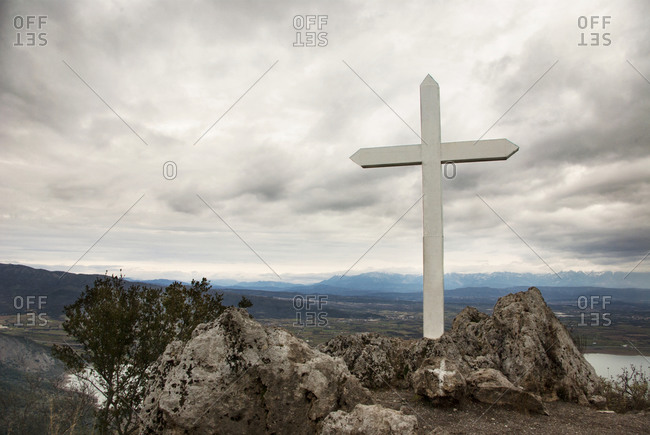 A wooden cross mounted on a hill