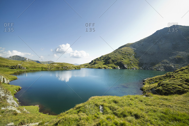 A remote lake in the green mountains of Romania
