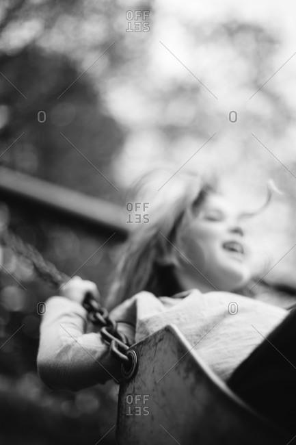 Girl playing on swingset