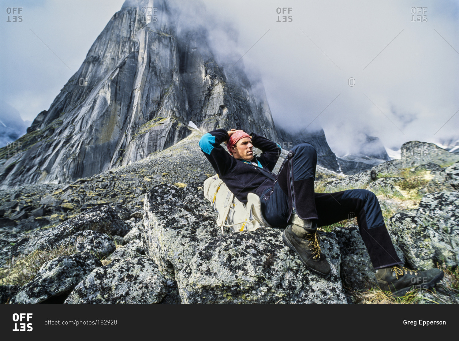 A climber resting on the approach to lotus flower tower in canada have any questions izmirmasajfo