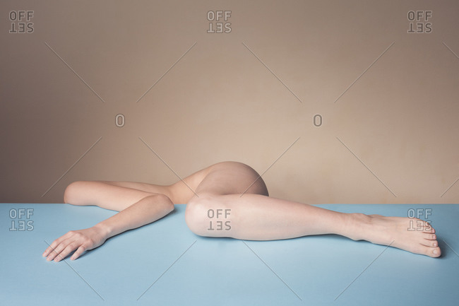Female body parts on blue surface