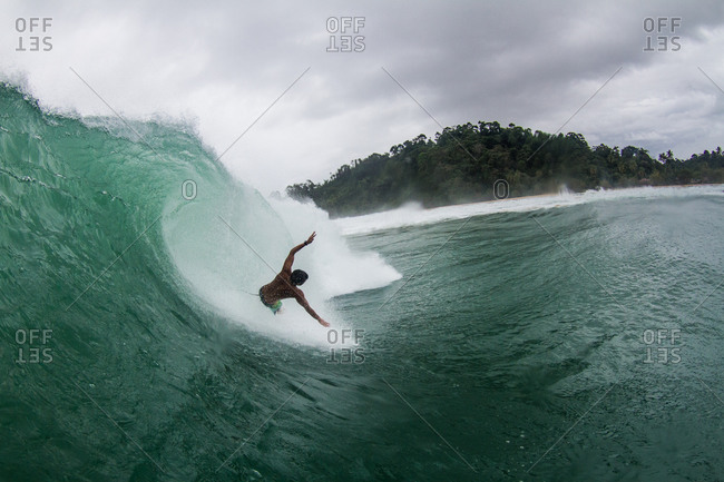 Surfer wiping out on a wave