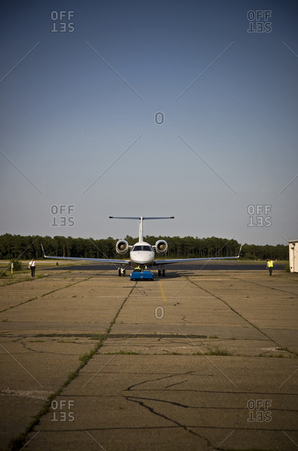 Islip, New York, USA - July 2, 2008: An airplane being pulled down the tarmac