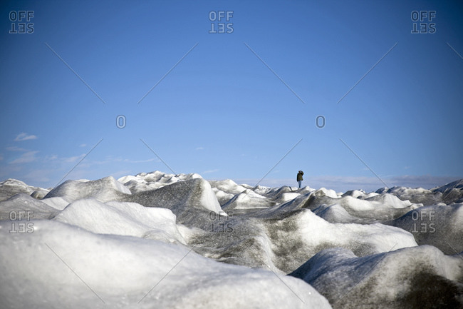 A man stands in a polar landscape