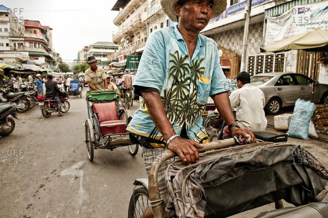 Phnom Penh, Cambodia - October 10, 2012: Cyclo driver in Phnom Penh, Cambodia