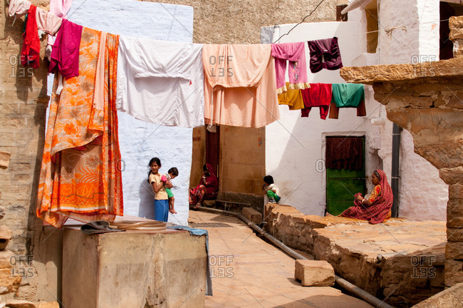Jaisalmer, Rajasthan, India - March 4, 2014: Rajasthani women outside their houses at Jaisalmer Fort