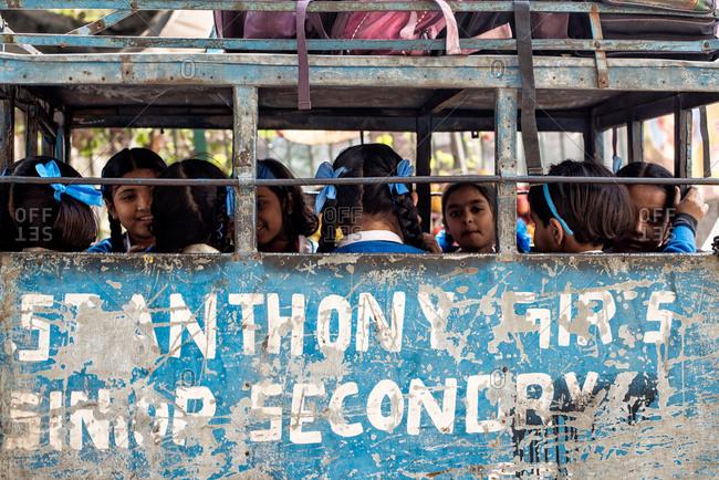 Delhi, India - February 25, 2014: Girls in India on school bus