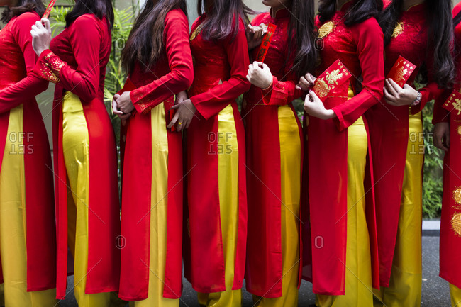 Vietnamese women in traditional dress at wedding