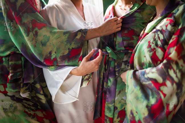 Women in robes preparing for wedding in Vietnam