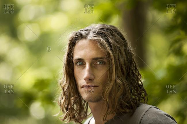 Portrait of man with shaggy medium length hair