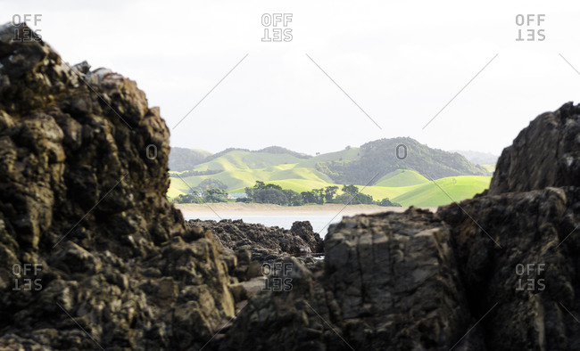 Rolling green hills and craggy rocks