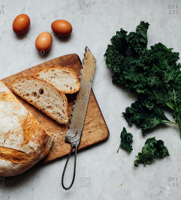 Cutting Bread on Wooden Board