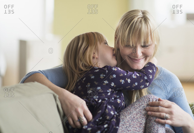 Daughter telling secret to mother