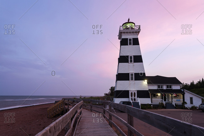 Prince Edward Island, Canada - November 11, 2010: West Point Lighthouse and sandy beach at dusk