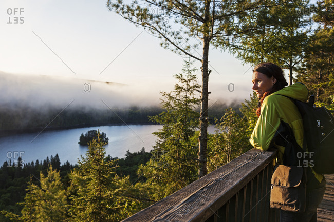 Woman looking at view from observation point