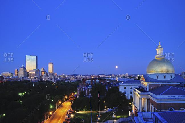 Massachusetts, USA - November 19, 2014: View of Massachusetts State House Dome and city skyline at moonrise