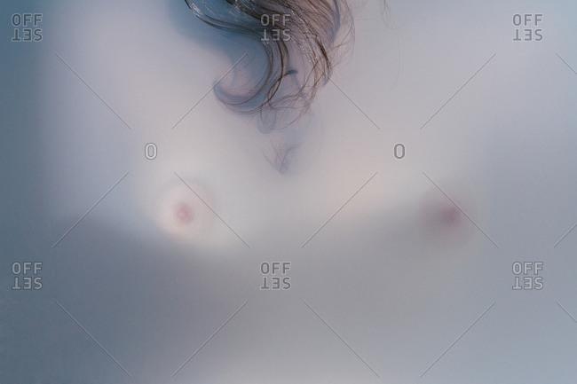 A woman's chest in a bathtub