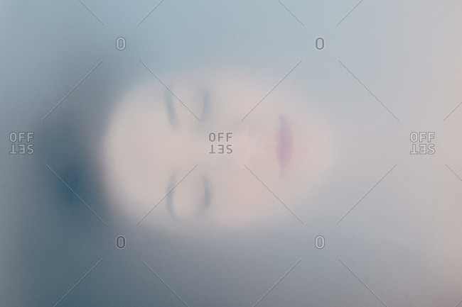 A woman's face in a bathtub