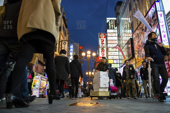 Osaka, Japan - December 31, 2014: Crowds of pedestrians at Shinsaibashi a busy shopping area