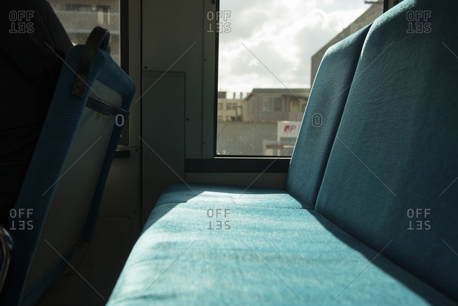 Osaka, Japan - January 1, 2015: Sunshine illuminating a train seat