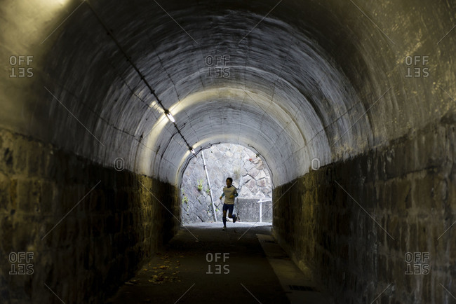 Kobe-shi, Japan - January 1, 2015: Man running in a tunnel