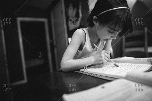 A girl works on homework