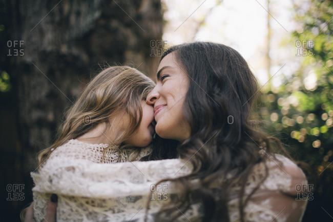 Girl snuggling on mom's shoulder