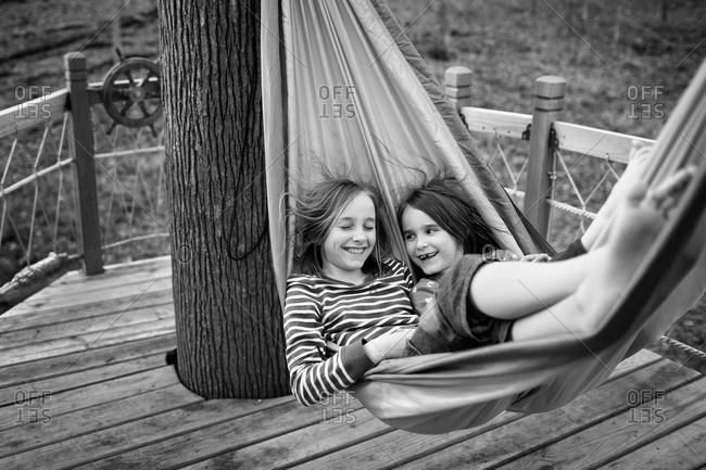 Young girls relaxing in a hammock