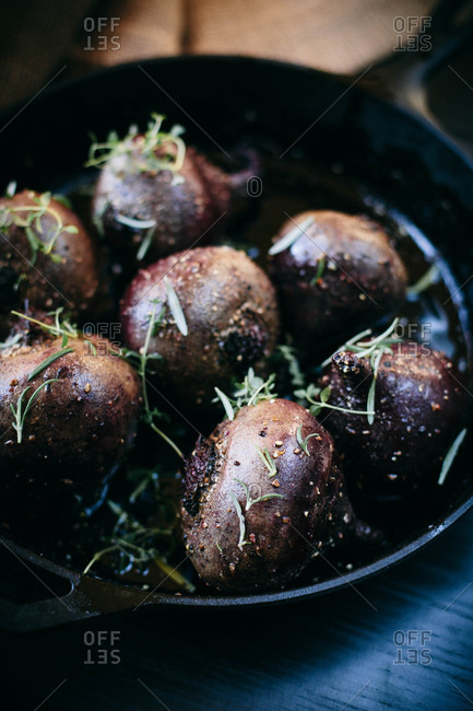 Beets and rosemary in a cast-iron skillet
