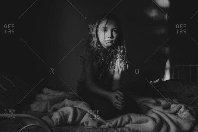 Portrait of girl sitting in her bed