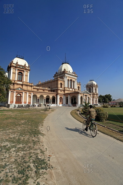 Man on bike approaching the Noor Mahal palace in Bahawalpur, Pakistan