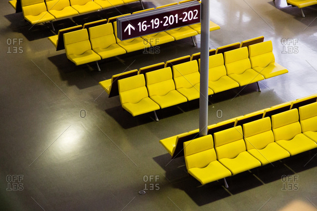 Yellow benches in a waiting room
