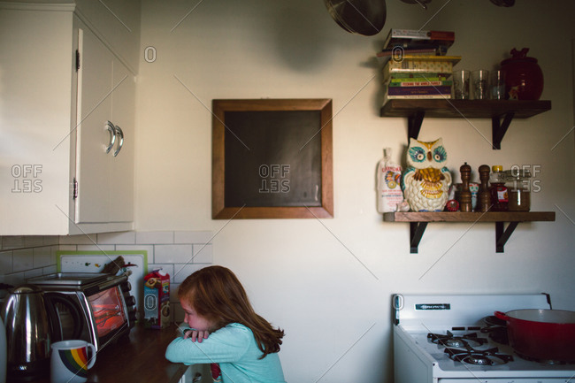 Young girl waiting for toaster oven