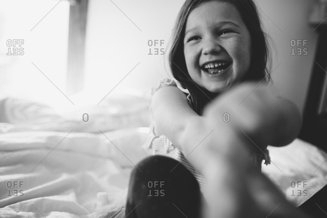 Portrait of gleeful young girl
