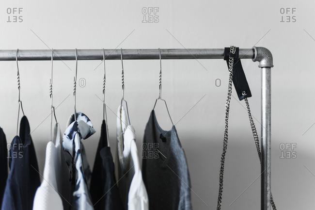 A wardrobe rack with menswear