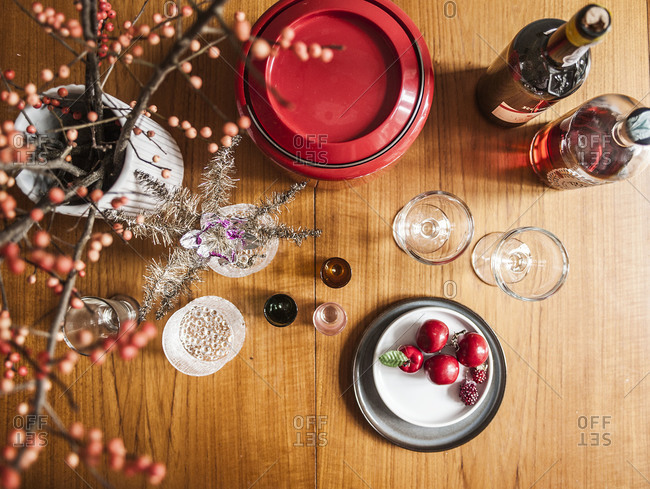 A table of Christmas decor and glasses