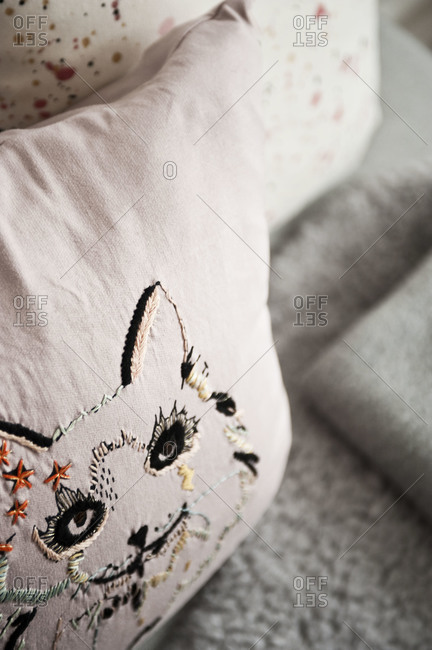 An embroidered pillow - Offset Collection