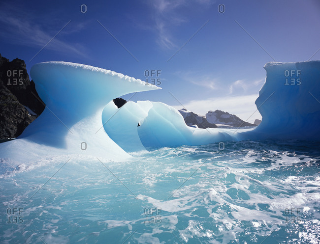 Melting icebergs under a blue sky