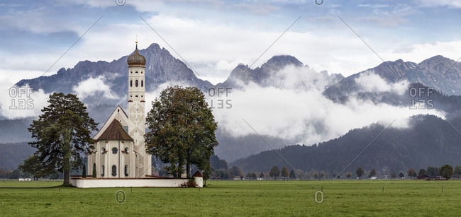 View to Koloman\'s Church in front of Tannheim Mountains