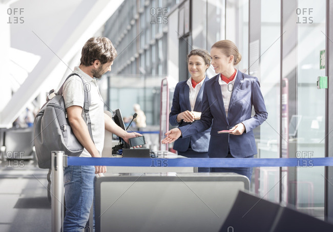 Tourist boarding at airport departure gate
