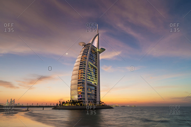 Dubai, United Arab Emirates - December 4, 2013: Burj AL Arab hotel at sunset