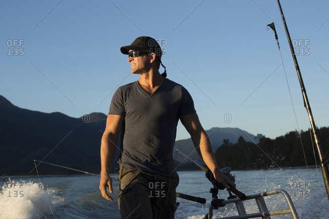 Portrait of man sport fishing on boat at Fraser River