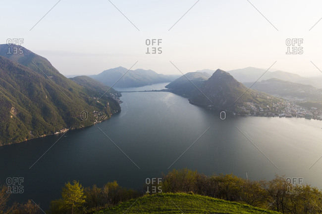 Elevated panorama view of Lugano and Monte San Salvatore at sunset