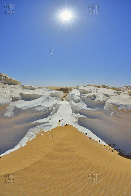Sun over rock formations in White Desert, Sahara Desert